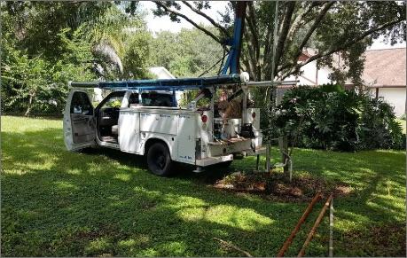 Jerrys Well Pump truck parked in yard, well repair is in progress